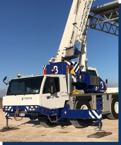 An ATF-40 Tonne All Terrain Tadano Crane with support legs extended